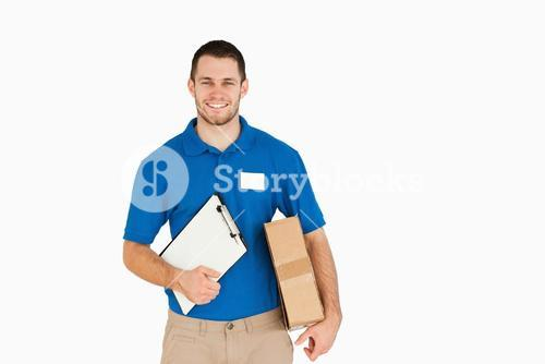 Smiling young salesman with parcel and clipboard
