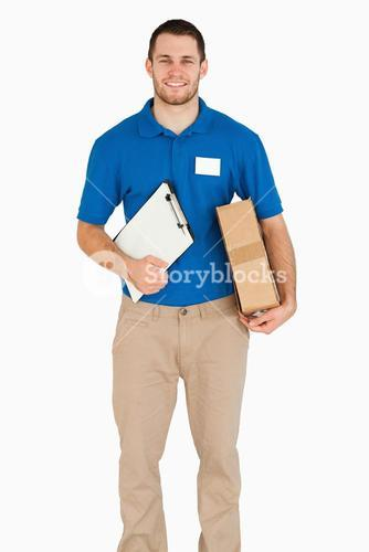 Smiling young salesman with packet and clipboard
