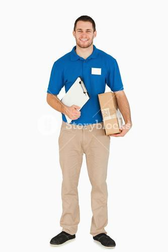 Smiling young salesman with clipboard and parcel