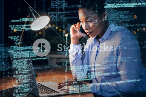 Businesswoman talking on mobile phone while working on laptop 3D