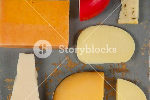 Variety of cheese on chopping board