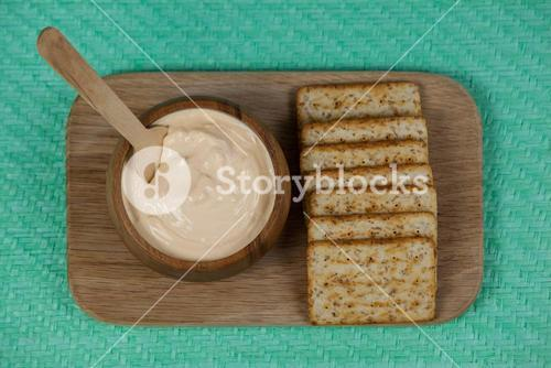 Cheese dip with garlic bread on placemat