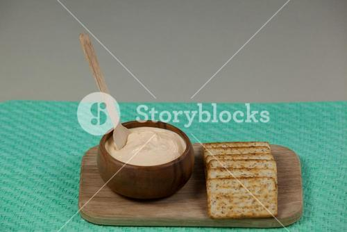 Cheese dip with garlic bread on serving board