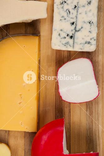 Various cheese on wooden board