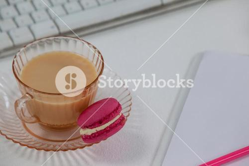 Cup of tea with a french macaroon