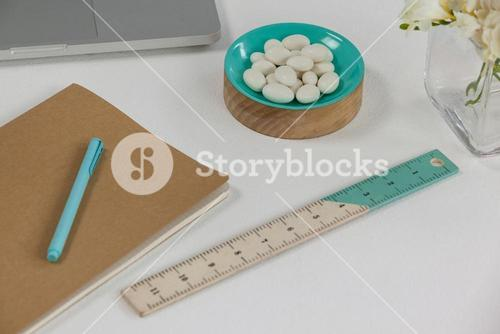 Ruler, pen, pebbles, and diary
