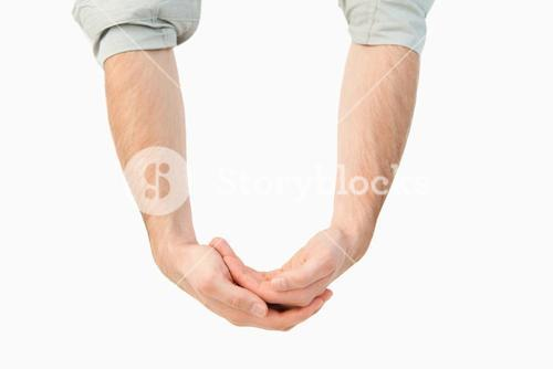 Male hands carrying something