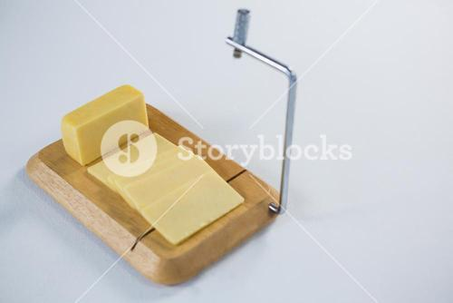 Cheese cutting board with slices of cheese