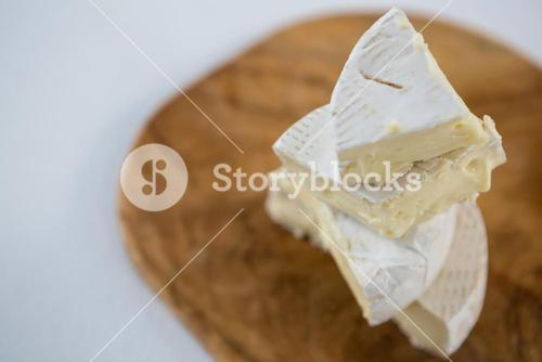 Brie cheese on wooden board