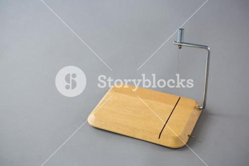 Cheese cutting board against grey background