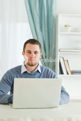 Businessman sitting in his homeoffice