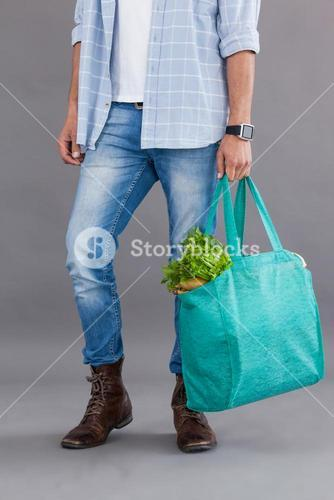 Man carrying grocery bag