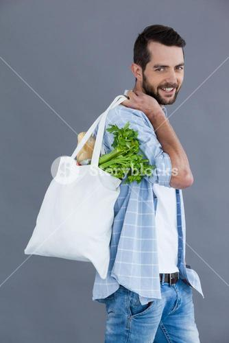 Man carrying a grocery bag