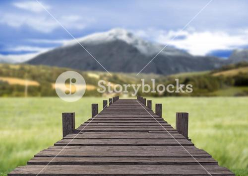 Wooden walkway against countryside landscape