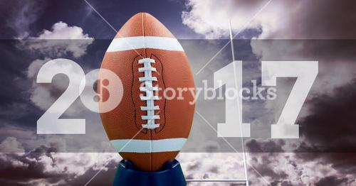 2017 new year message with football against cloudy background