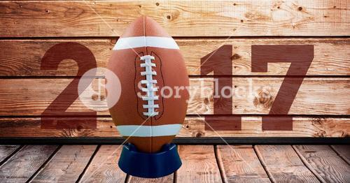 2017 new year message with football against wooden background
