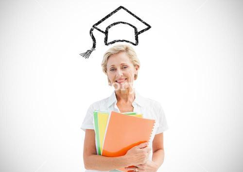 Senior woman holding files with graduation cap in background