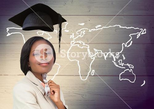 Woman with graduation cap and world map on wooden background