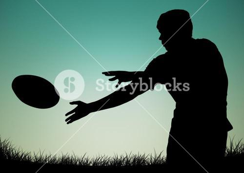 Silhouette of player catching a ball