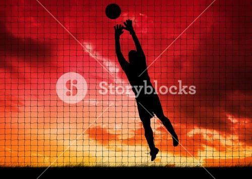 Silhouette of player catching a ball against net and sky in background