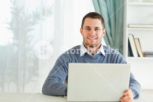 Man with his notebook in his homeoffice