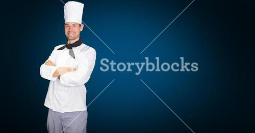 Chef standing with arms crossed against blue background