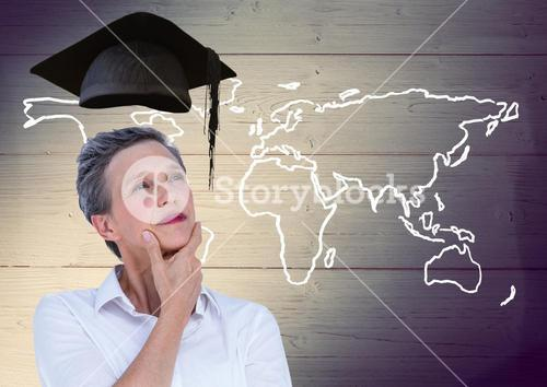 Thoughtful woman with graduation cap and world map on wooden background