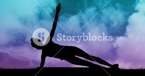 Silhouette of woman practicing yoga on grass against sky background