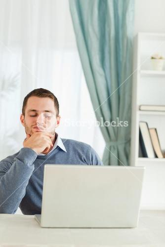 Businessman thinking in his homeoffice