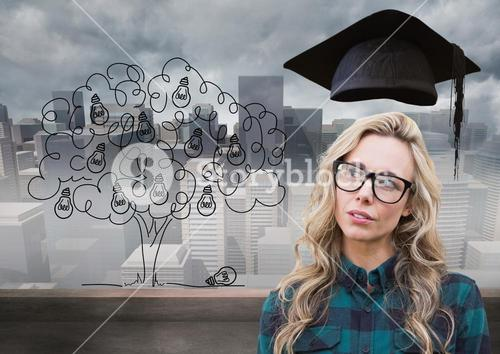 Thoughtful woman with graduation cap against cityscape in background
