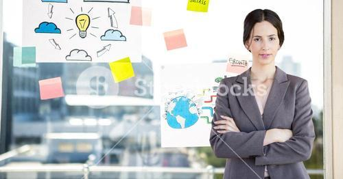 Businesswoman standing with arms crossed against sticky notes in background