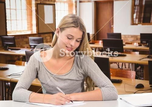 Woman writing notes in computer lab