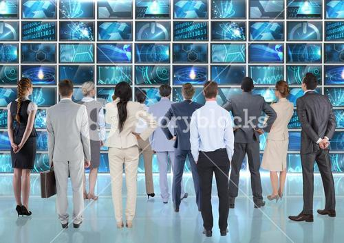Business executives looking at digital computer interface