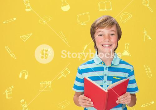 Boy holding a book against school background