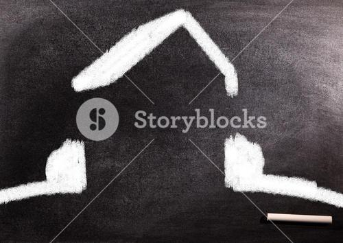 White outlined home icon on blackboard