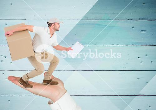 Hand holding a delivery man carrying a parcel box against wooden plank background
