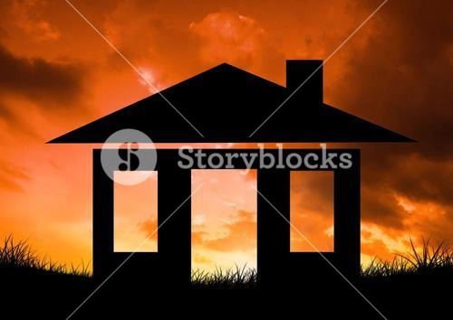 Silhouette of home icon against sunset background
