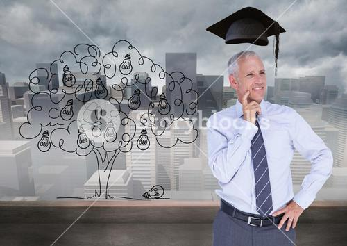 Thoughtful businessman with graduation cap against cityscape in background