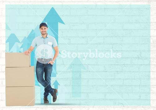 Delivery man standing with courier boxes against blue brick wall background
