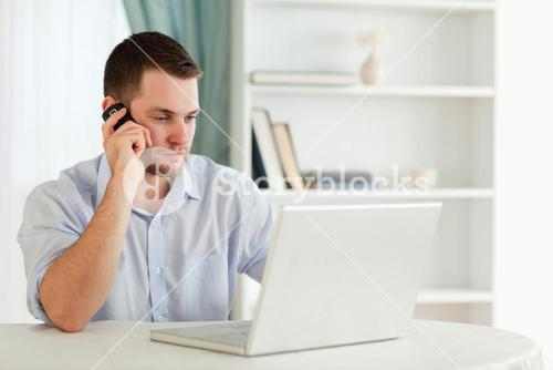 Businessman in his homeoffice calling