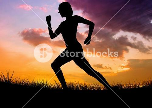 Silhouette of female athlete running on grass