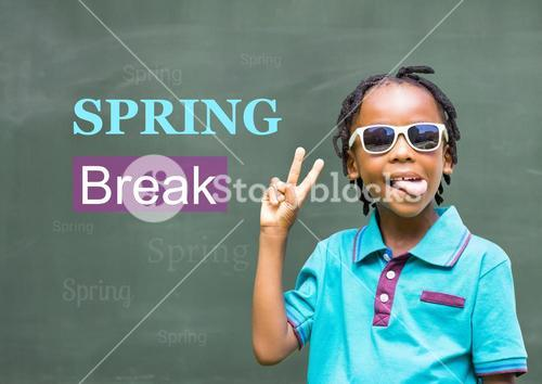 Schoolboy wearing sunglasses and gesturing with spring break text against chalkboard