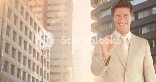 Happy business executive gesturing against city background