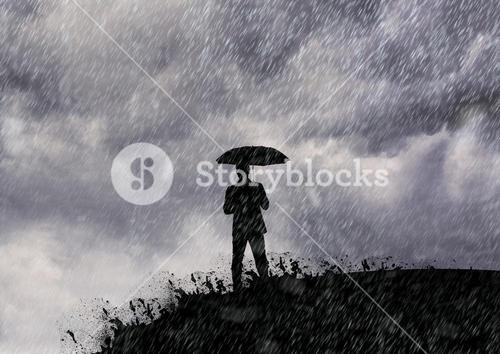 Man standing with umbrella in the rain