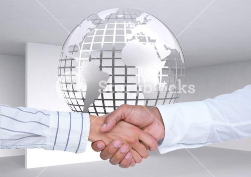 Executives shaking hands against globe