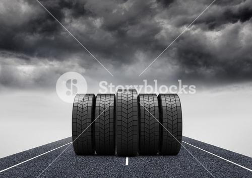 Tyres kept on asphalt road during stormy weather