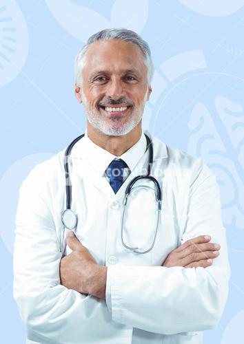 Male doctor standing with arms crossed against medical background