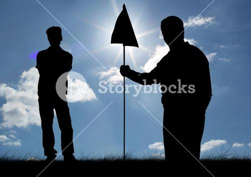 Silhouette of golfer holding golf flag on a sunny day