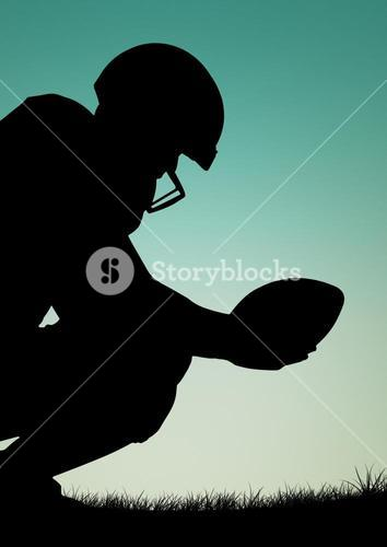 Silhouette of athlete holding ruby ball against blue sky