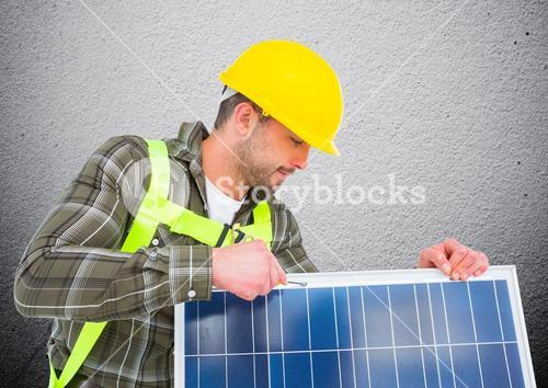 Composite image of man fixing solar panel